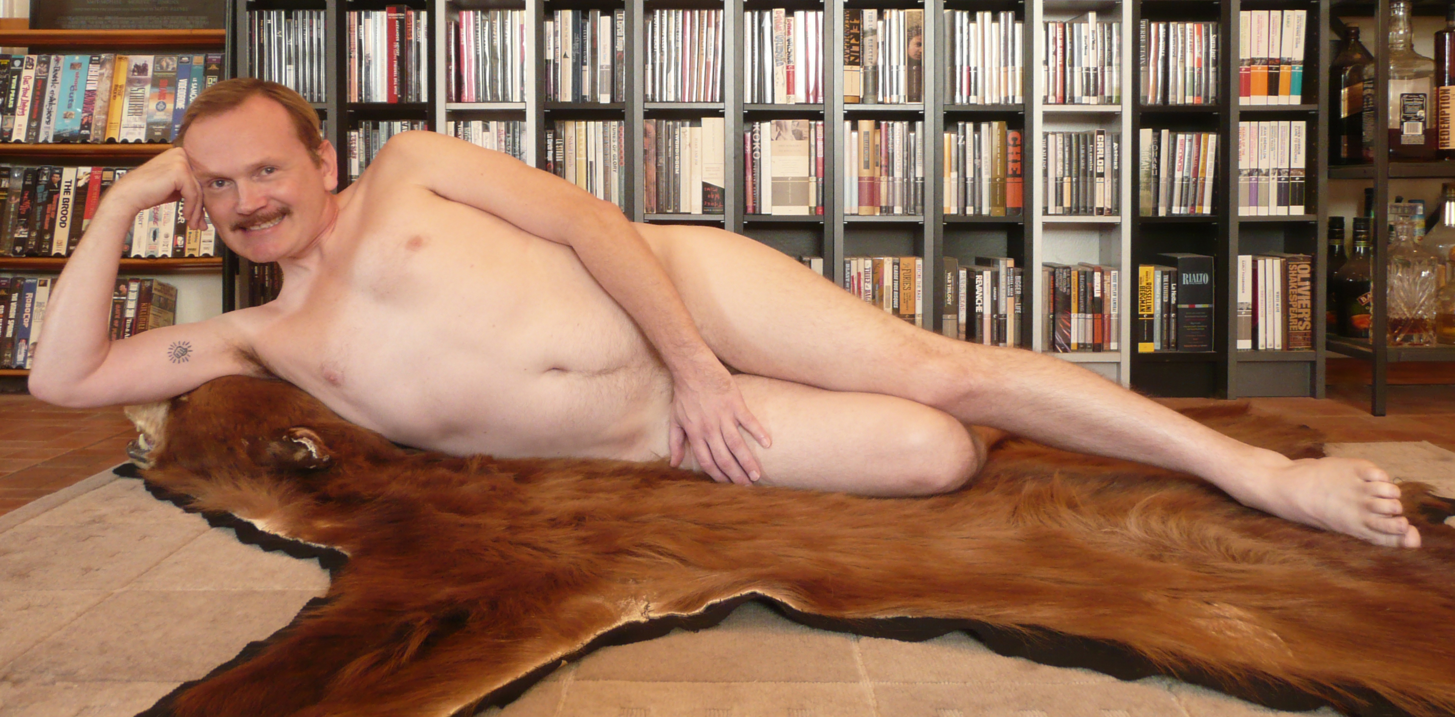 Naked rug a skin on woman bear